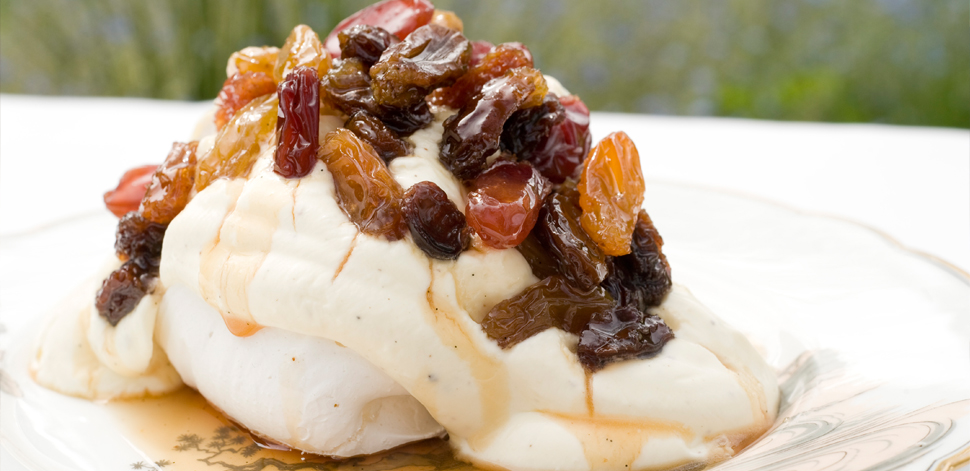 pavlovas and vanilla creme fra 238 che with poached raisins in dessert wine