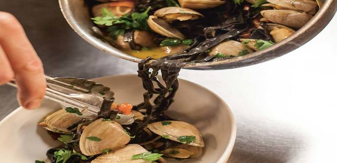 Squid Ink Pasta & Clams with Chorizo & Tomato Broth